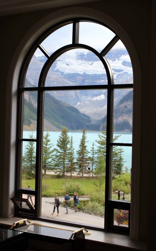 Lake Louise at sunrise - from the hotel room window.   Lake Louise reflections.  The Fairmont, Lake Louise, Canada.