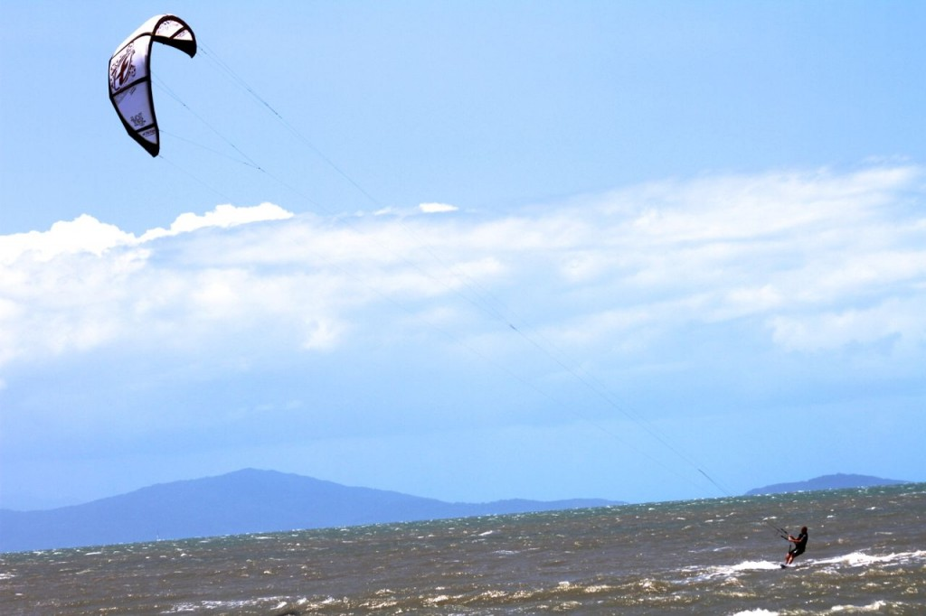 Kitesurfing at Four Mile Beach, Port Douglas, Queensland, Australia.