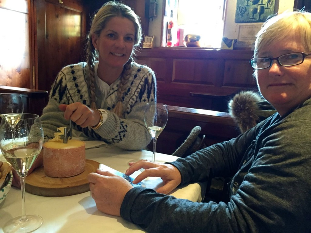 Melissa & Brig enjoying a cheese wheel and some Prosecco in Cortina, Italy.