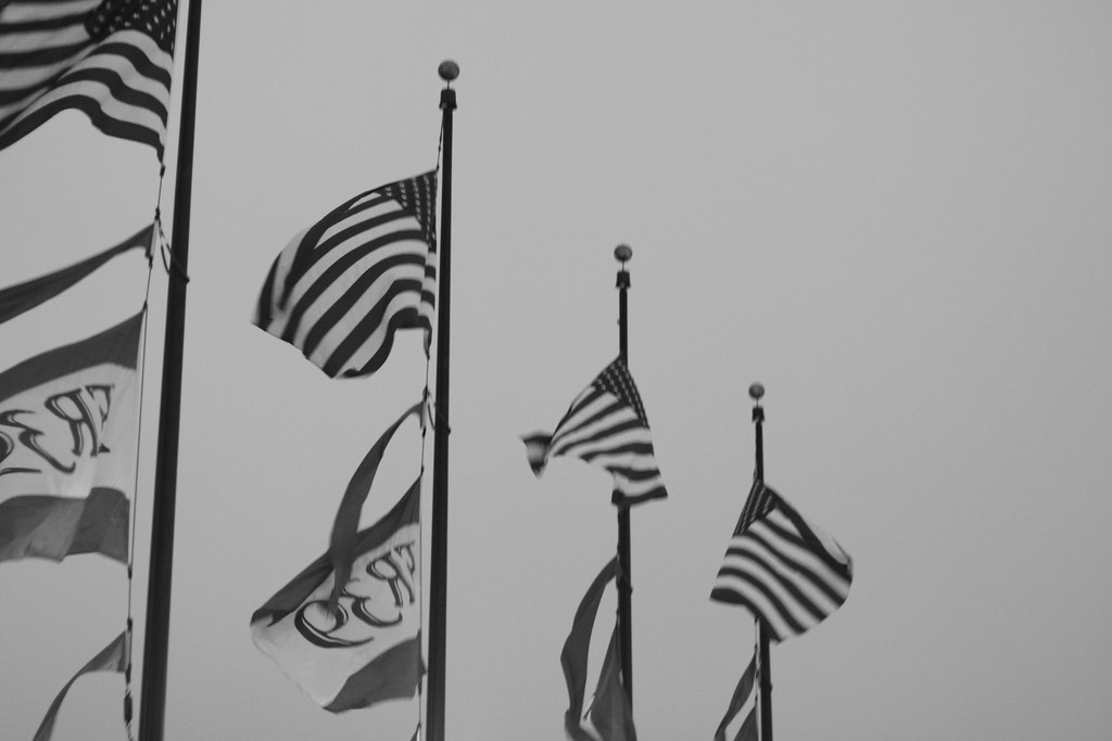 Flags flying at Pier 39 on Fourth of July in San Francisco, California, USA