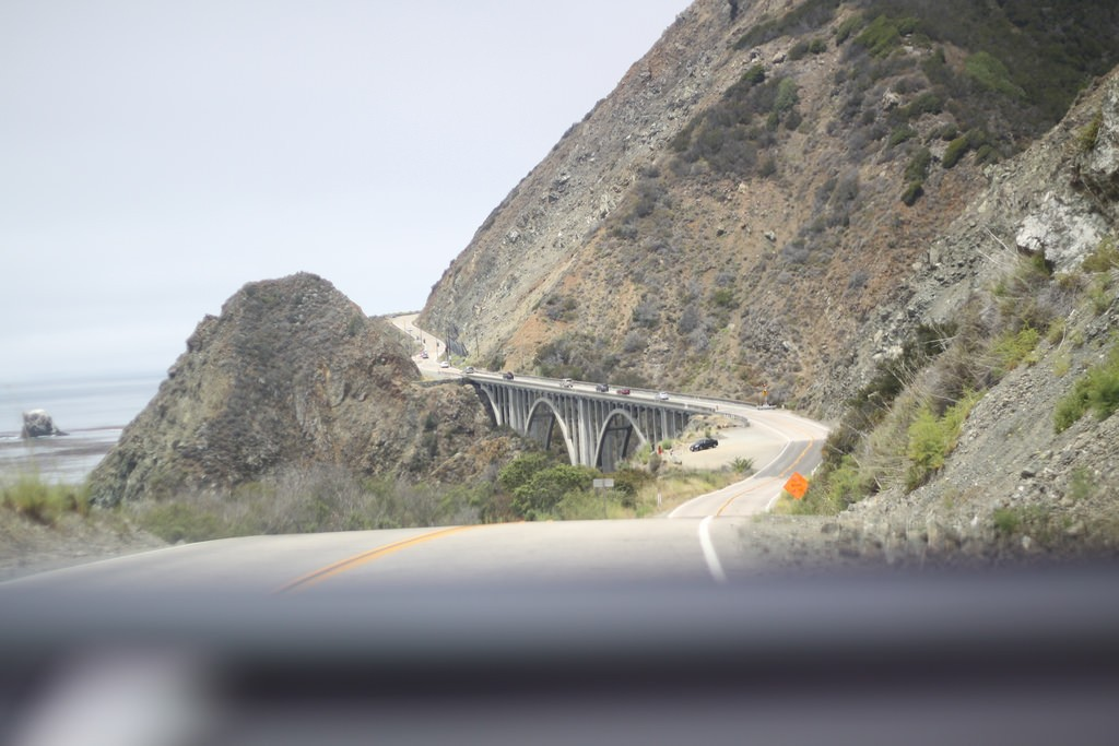 View from the car of Big Creek Bridge on the Pacific Coast Highway, California, USA.